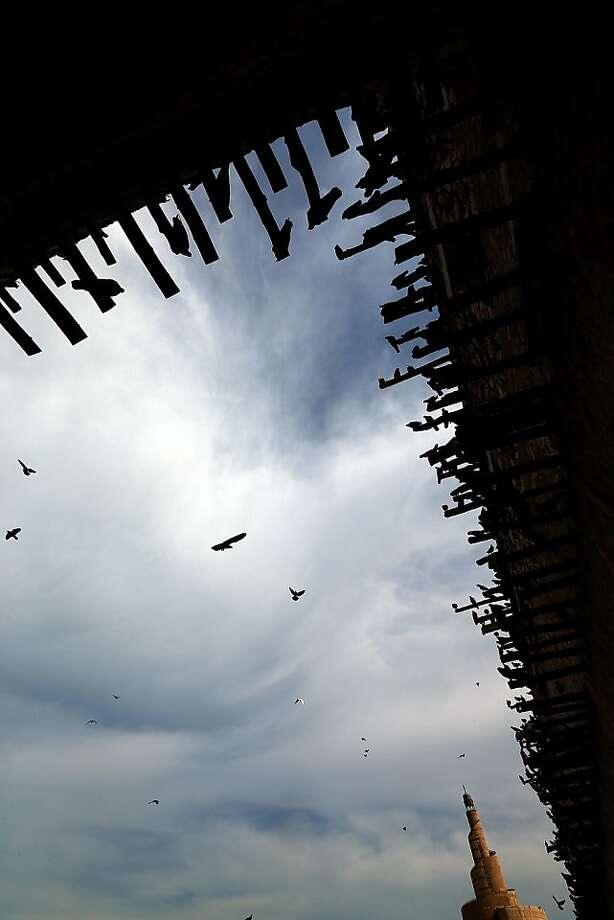 Pigeons perch on wooden struts on a traditional building in Souq Waqif where the Doha Tribeca Film Festival is taking place on November 19, 2012. Photo: Karim Sahib, AFP/Getty Images