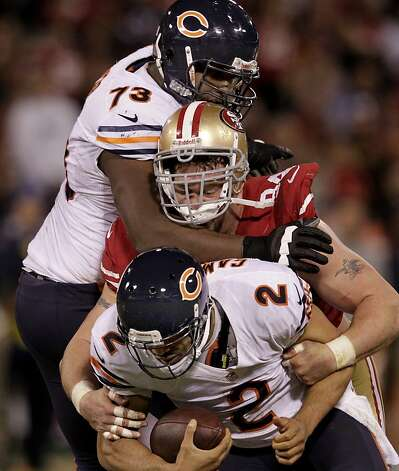 Justin Smith (center) sacked quarterback Jason Campbell in the fourth quarter with J Marcus Webb on his back. The San Francisco 49ers defeated the Chicago Bears 32-7 at Candlestick Park Monday November 19, 2012. Photo: Brant Ward, The Chronicle