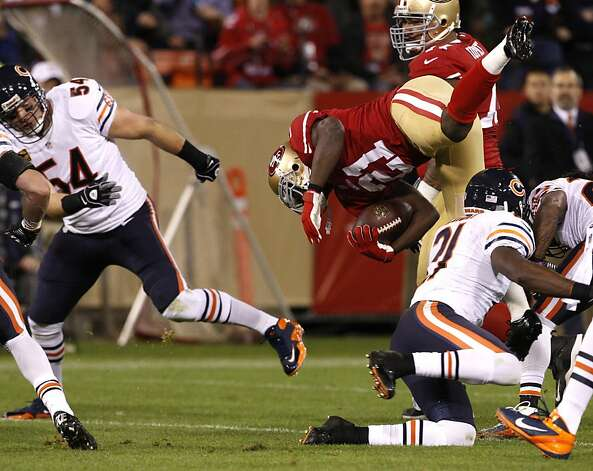 Running back Frank Gore (21) flies through the air after a tackle in the first half of the San Francisco 49ers game against the Chicago Bears at Candlestick Park in San Francisco, Calif., on Sunday November 19, 2012. Photo: Carlos Avila Gonzalez, The Chronicle