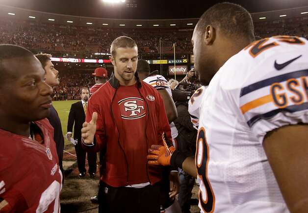 Alex Smith said got a greeting from Michael Bush of the Bears at the end of the game. The San Francisco 49ers defeated the Chicago Bears 32-7 at Candlestick Park Monday November 19, 2012. Photo: Brant Ward, The Chronicle