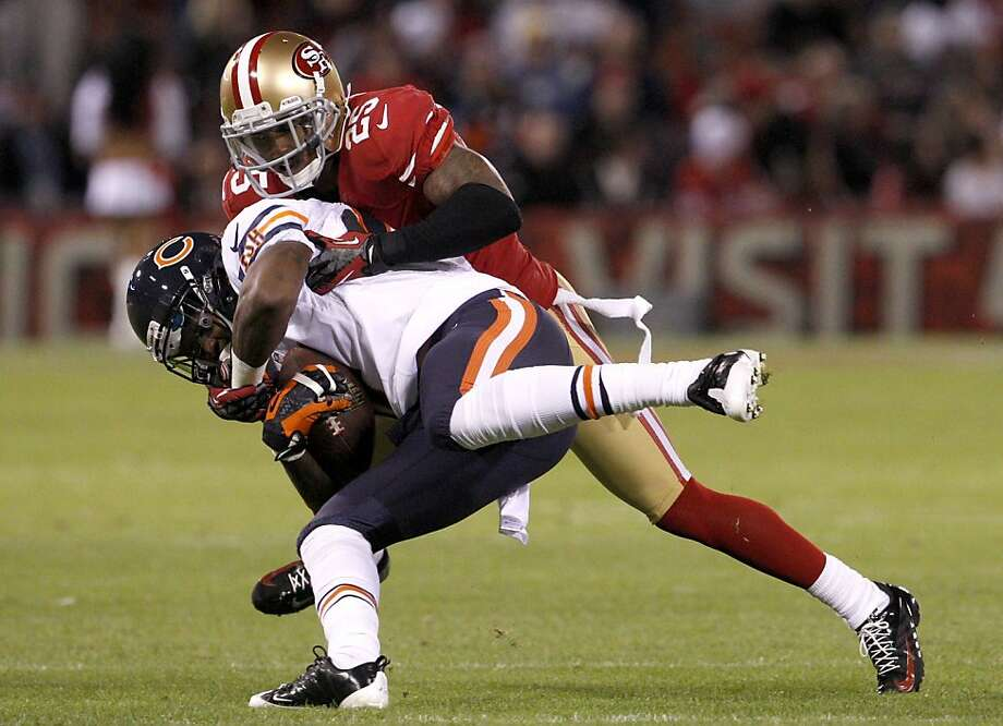 Cornerback Tarell Brown (25) tackles Chicago wide receiver Alshon Jeffery (17) during the first half of the San Francisco 49ers game against the Chicago Bears at Candlestick Park in San Francisco, Calif., on Sunday November 19, 2012. Photo: Carlos Avila Gonzalez, The Chronicle
