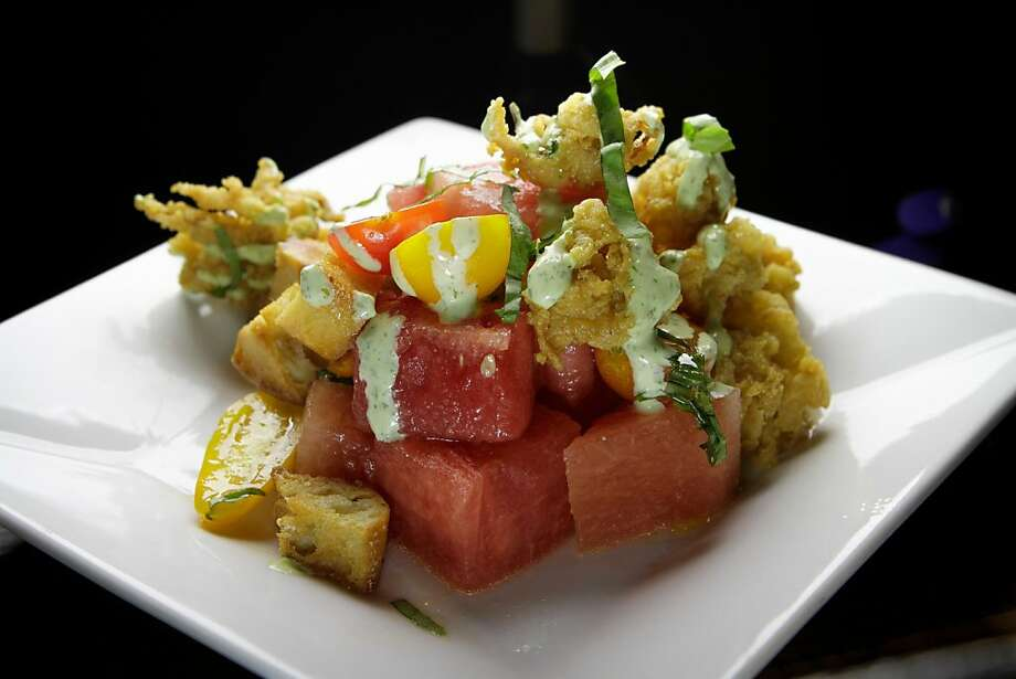 Lincoln Park chef Stephen Simmons' Watermelon Panzanella with Crispy Calamari is one spectacular dish. Photo: John Storey, Special To The Chronicle