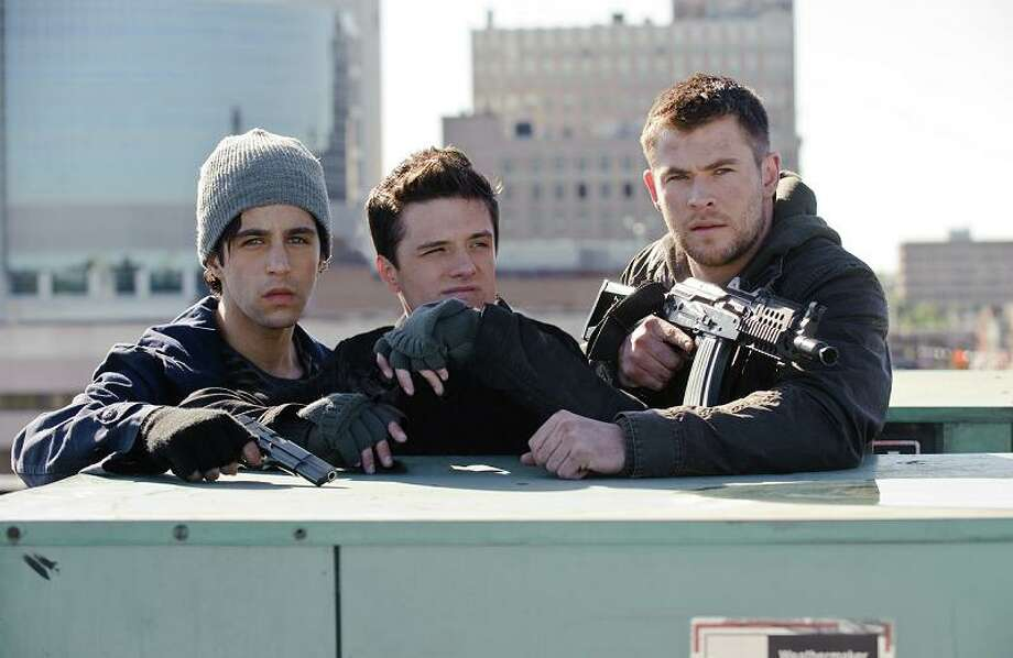 "The cast of ""Red Dawn"" fight the North Koreans. These three wussies won't be much help, but luckily, in the real world, they would have a lot of backup. Click through to see our top 15 reasons this scenario will never ever happen ... (Photo: Ron Phillips/Film District/MCT) Photo: Ron Phillips, McClatchy-Tribune News Service / MCT"