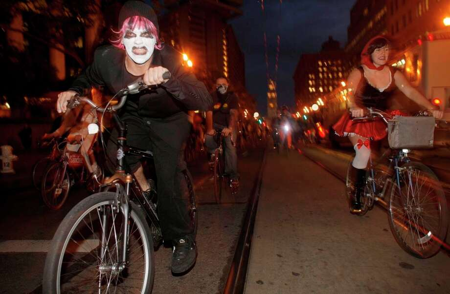 "11. CRITICAL MASS:These bicyclists would welcome the invaders if they produced carbon credits to offset the emissions made by their aircraft and tanks. But the ""Red Dawn"" bombers are running on leaded fuel. So park your tank on the other side of Market Street and read your smart phone for 45 minutes like everyone else.  Photo: Michael Macor, The Chronicle / SFC"