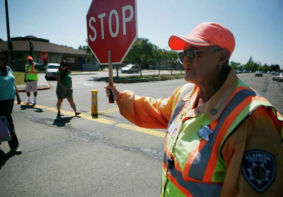 9. CROSSING GUARDS: I once saw a guard stare down a driver so hard that her Acura SUV burst into flames. Next to the secret service, crossing guards are the most aggressively protective force in the country. No way an invasion gets near a school -- especially between the hours of 7:20 to 9 a.m. and 2:50 to 4 p.m.  Photo: Anna Vignet, The Chronicle / SFC