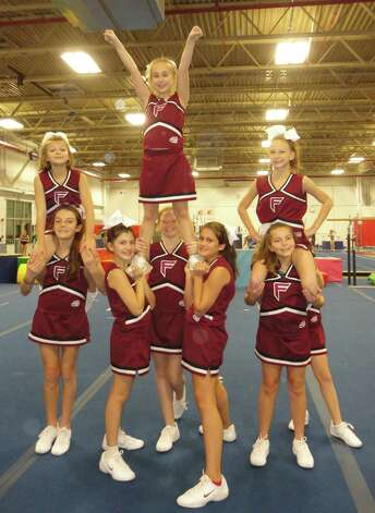 The Fairfield PeeWee Giants cheerleaders are raising money to travel to the Pop Warner National Championship at Disneyís Wide World of Sports Complex in Orlando, Fla., next month. Photo: Meg Barone / Fairfield Citizen freelance