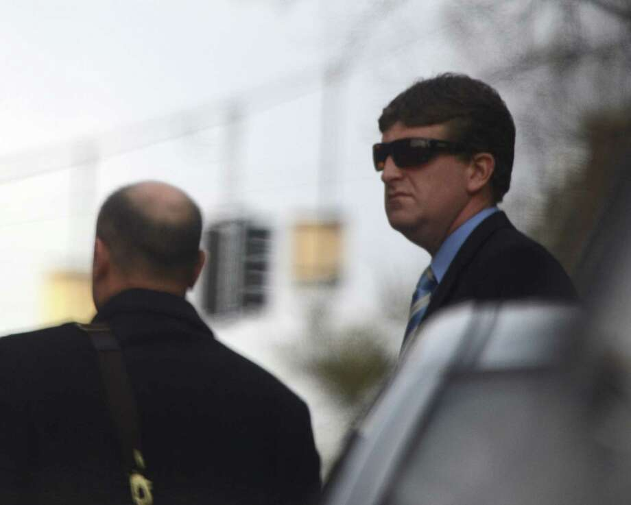 Saratoga Police Officer Edward Braim, right, accompanied by his attorney, Andy Safranko, enters Saratoga City Courthouse in Saratoga Springs on Tuesday, Nov. 20, 2012.   (Skip Dickstein/Times Union) Photo: SKIP DICKSTEIN