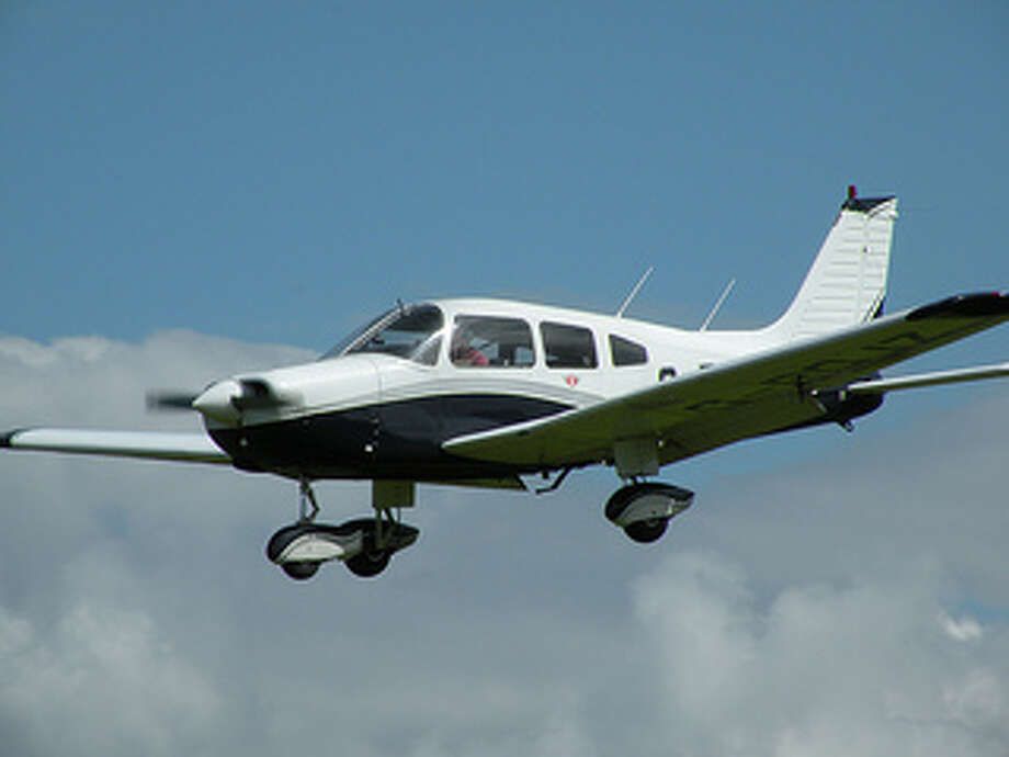 A file photo of a single-engine Piper airplane.  A Piper PA32 flying from Placer County to Oakland lost contact with air traffic controllers about 10 miles from Oakland airport.