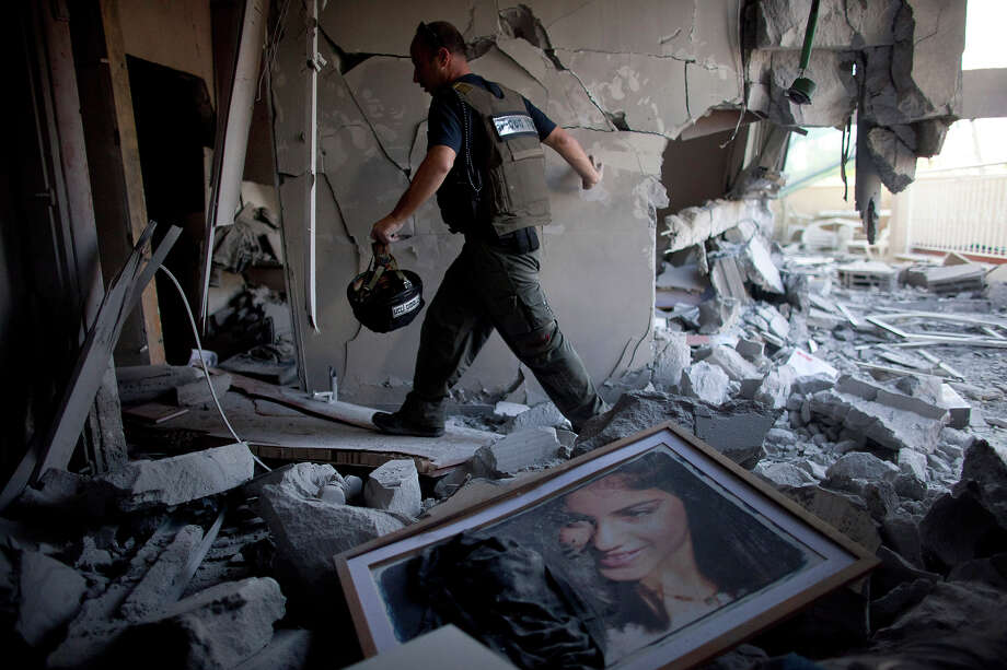 BEERSHEBA, ISRAEL - NOVEMBER 20: (ISRAEL OUT) A bomb disposal officer at a house after it was hit by a rocket fired from the Gaza Strip on November 20, 2012 in Beersheba, Israel. Hamas militants and Israel are continuing talks aimed at a ceasefire as the death toll in Gaza reaches over 100 with three Israelis also having been killed by rockets fired by Palestinian militants. Photo: Uriel Sinai, Getty Images / 2012 Getty Images