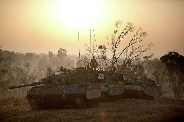 ISRAEL/GAZA BORDER, ISRAEL - NOVEMBER 20:  (ISRAEL OUT) Israeli soldiers prepare weapons and vehicles in a deployment area as the conflict between Palestine and Gaza enters its seventh day on November 20, 2012 on Israel's border with the Gaza Strip. Hamas militants and Israel are continuing talks aimed at a ceasefire as the death toll in Gaza reaches over 100 with three Israelis also having been killed by rockets fired by Palestinian militants. Photo: Uriel Sinai, Getty Images / 2012 Getty Images