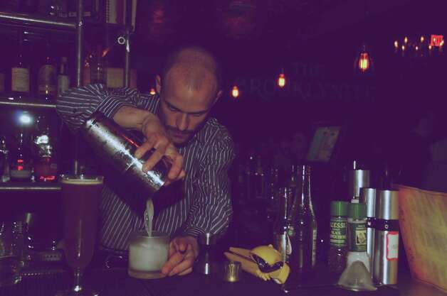 Rob Gourlay is carefully mixing drinks behind the bar at The Brooklynite.