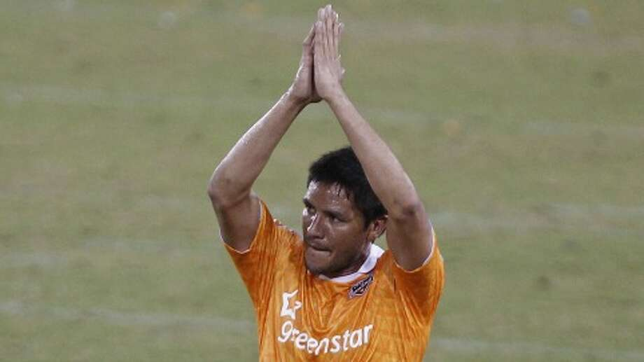 The Houston Dynamo's Brian Ching claps his hands as he leaves the game in the second period of MLS game action against the LA Galaxy at Robertson Stadium Sunday, Oct. 23, 2011, in Houston. ( James Nielsen / Chronicle )