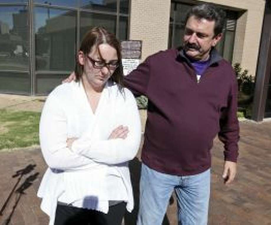 Heather Sanchez walks with attorney Bob Pottroff after speaking at a press conference in Midland on Monday. Her husband, U.S. Army Sgt. Richard Sanchez is one of three people who remain hospitalized after Thursday's crash Photo: Edward A. Ornelas, Staff /  2012 San Antonio Express-News