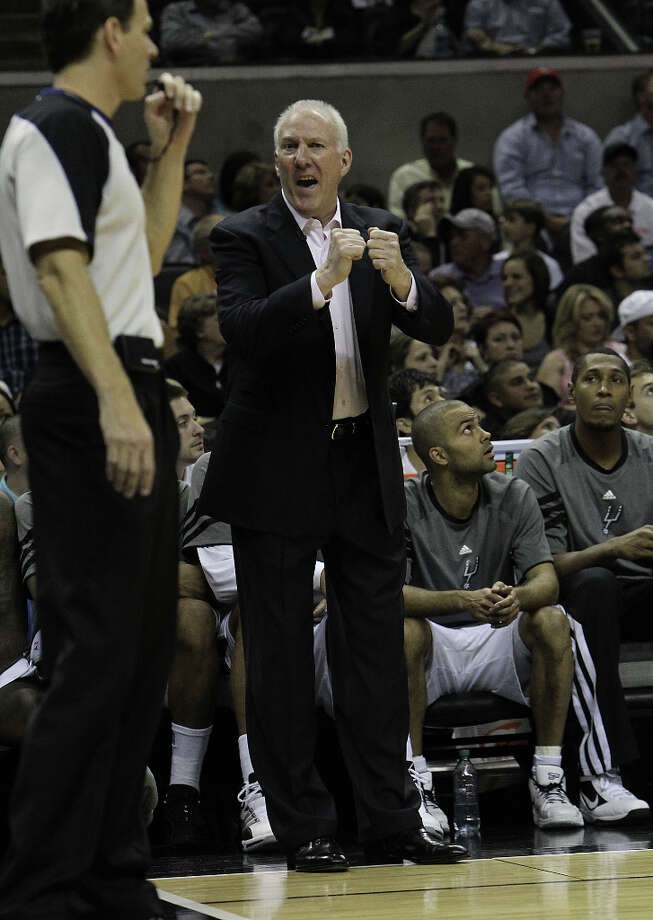 Spurs coach Gregg Popovich debates a call with a game official during the first half against the Los Angeles Lakers at the AT&T Center on Friday, Apr. 20, 2012. Kin Man Hui/Express-News. Photo: Kin Man Hui, San Antonio Express-News / ©2012 San Antonio Express-News