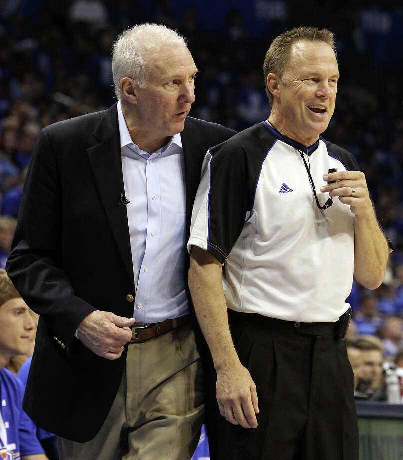 San Antonio Spurs coach Gregg Popovich walks around official Bill Spooner during the second half of game three of the NBA Western Conference Finals in Oklahoma City, Okla. on Thursday, May 31, 2012. Photo: Kin Man Hui, San Antonio Express-News / © 2012 San Antonio Express-News