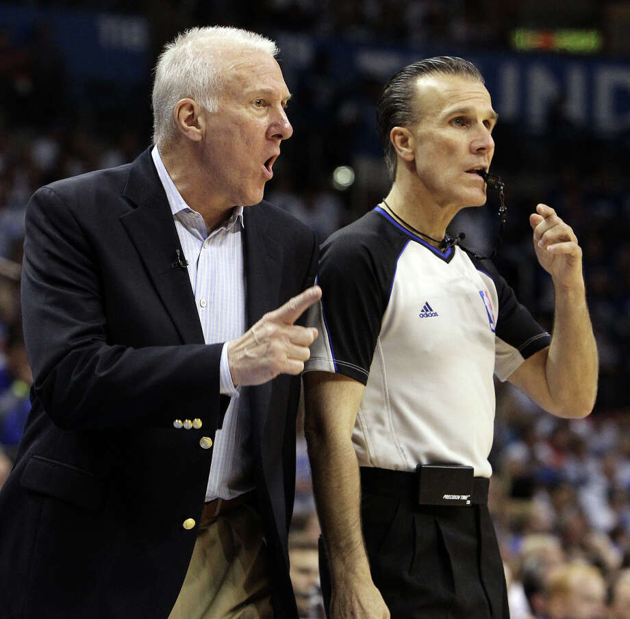 San Antonio Spurs coach Gregg Popovich talks to official Ken Mauer during the second half of game four of the NBA Western Conference Finals in Oklahoma City, Okla. on Saturday, June 2, 2012. Photo: Kin Man Hui, San Antonio Express-News / © 2012 San Antonio Express-News