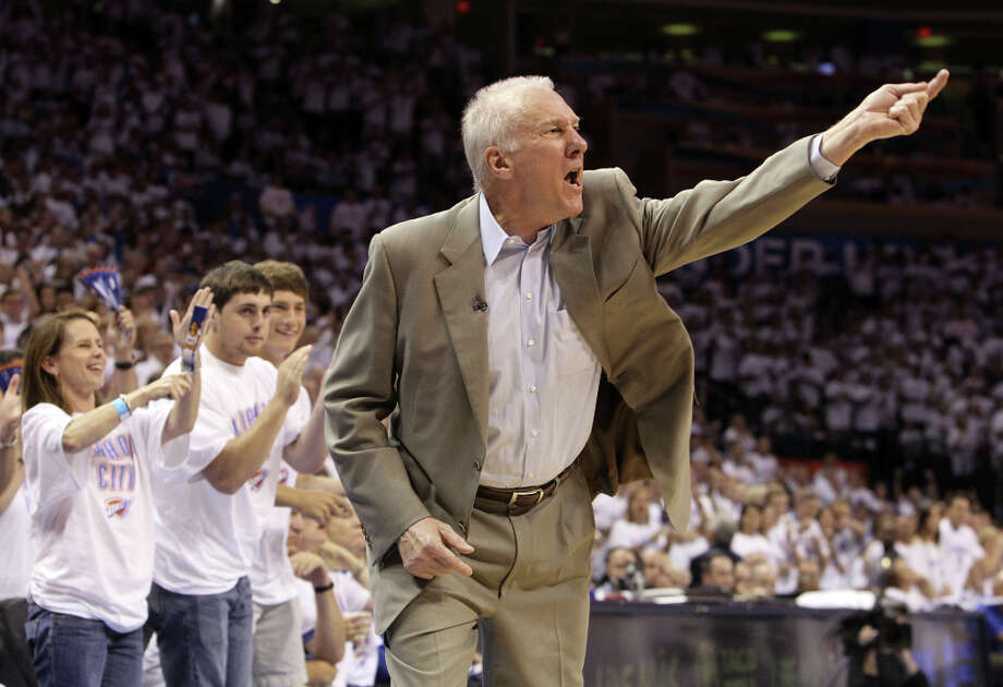 San Antonio Spurs coach Gregg Popovich gestures during the second half of game six of the NBA Western Conference Finals in Oklahoma City, Okla. on Wednesday, June 6, 2012. Photo: Kin Man Hui, San Antonio Express-News / © 2012 San Antonio Express-News