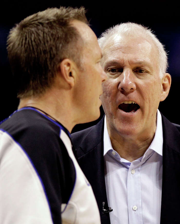 San Antonio Spurs head coach Gregg Popovich argues with referee Bill Spooner (22) during the second half of Game 3 in their NBA basketball Western Conference finals playoff series against the Oklahoma City Thunder, Thursday, May 31, 2012, in Oklahoma City. The Thunder won 102-82. (AP Photo/Eric Gay) Photo: Eric Gay, Associated Press / AP