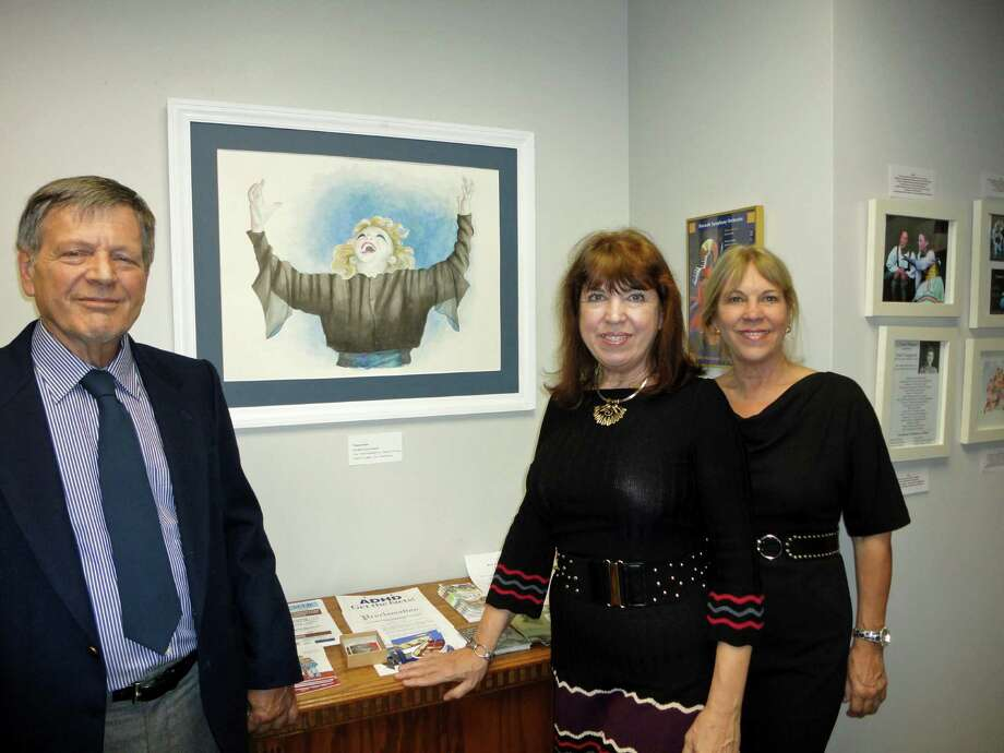 Depicted here are three of the four founders of the Crystal Theatre, from left to right: Mariner Pezza, who painted the picture on the wall on display in the Mayor's Gallery, Cheryl Kemeny and her sister Alexandra. Photo: Meg Barone