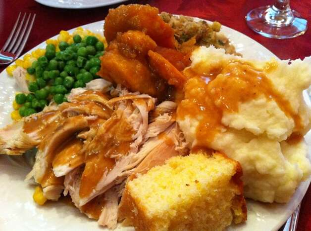 Thanksgiving meals can be enjoyed months down the road by putting plate lunches in freezer safe containers for long term storage. Get the food put away as soon as possible to avoid contamination. Photo: Submission