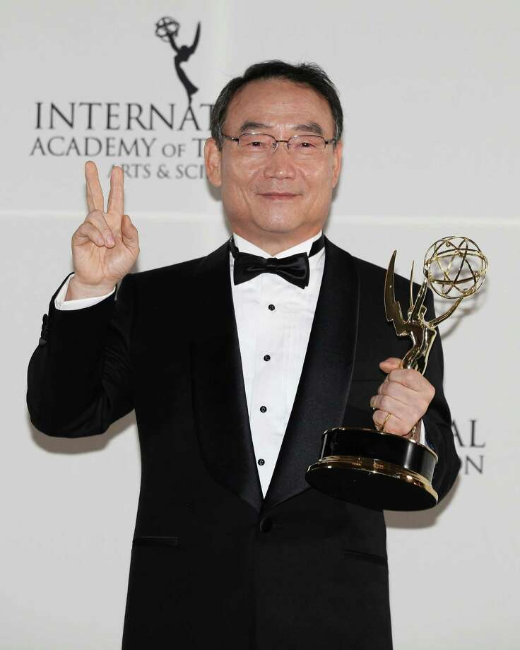 This Nov. 19, 2012 photo released by Starpix shows Dr. Kim In-Kyu, president and CEO of the Korean Broadcasting System, after winning the Directorate Award at the 40th International Emmy Awards in New York. Photo: Andrew Toth, AP / STARPIX