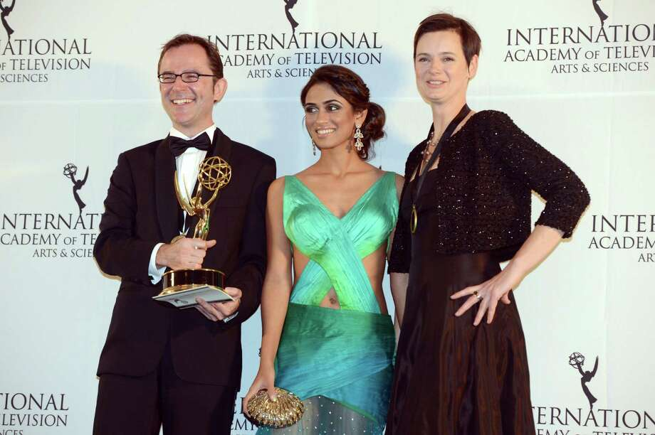 "Tristan Chytroschek, left, Susanne Mertens, right, of Germany pose with presenter Prerna Wanvari after winning the Arts Programming award for ""Songs of War"" at the 40th International Emmy Awards,  Monday, Nov. 19, 2012 in New York. Photo: Henny Ray Abrams, AP / FR151332 AP"