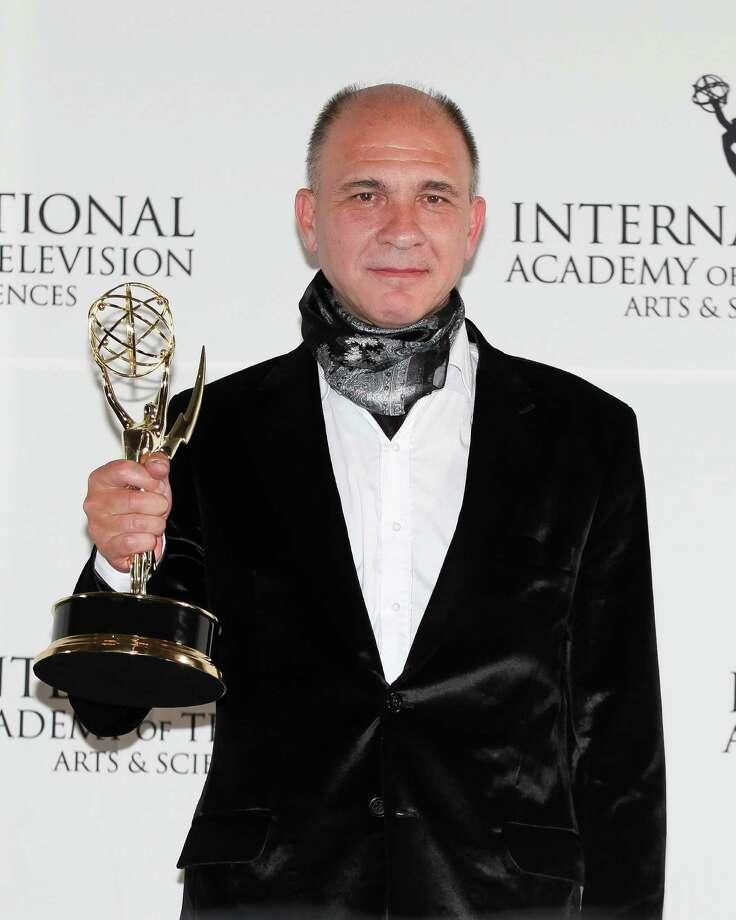 "This Nov. 19, 2012 photo released by Starpix shows Dario Grandinetti, of Argentina, holding his award for Best Performance by an Actor for ""Television X La Inclusion - Suelo Argentino"" at the 40th International Emmy Awards in New York. Photo: Andrew Toth, AP / STARPIX"