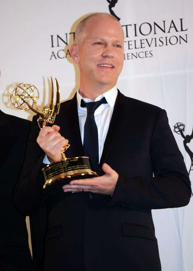 Ryan Murphy poses with his trophy after winning the Founders Award at the 40th International Emmy Awards,  Monday, Nov. 19, 2012 in New York. Photo: Henny Ray Abrams, AP / FR151332 AP
