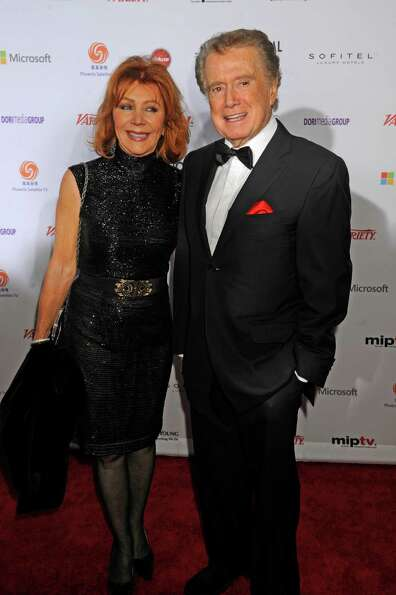 Regis Philbin, right, and his wife Joy Philbin arrive for the 40th International Emmy Awards, Monday