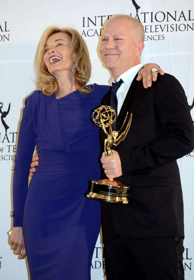 Ryan Murphy, right, poses with presenter Jessica Lange after winning the Founders Award at the 40th International Emmy Awards,  Monday, Nov. 19, 2012 in New York. Wilkins was Pratchett's assistant. Photo: Henny Ray Abrams, AP / FR151332 AP