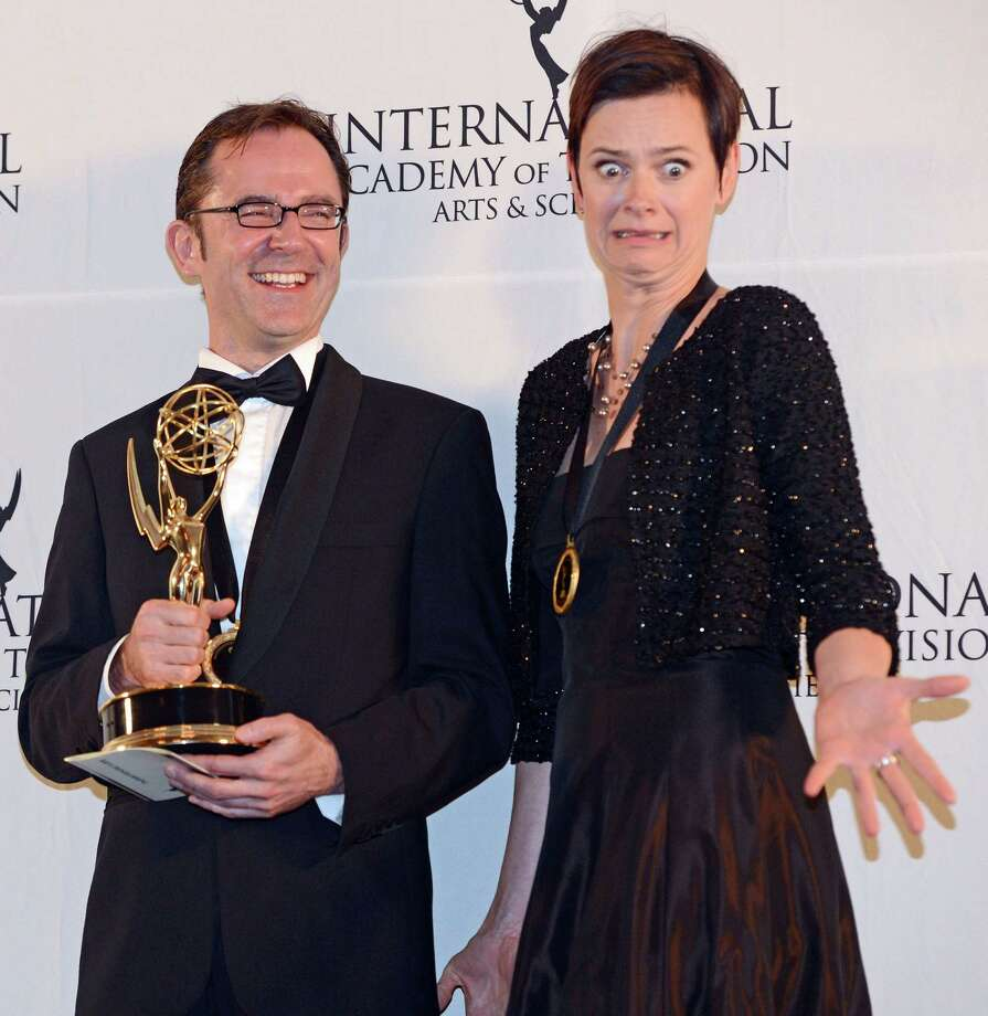 "Tristan Chytroschek, left, and Susanne Mertens of Germany pose with their statues after winning the Arts Programming award for ""Songs of War"" at the 40th International Emmy Awards,  Monday, Nov. 19, 2012 in New York. Photo: Henny Ray Abrams, AP / FR151332 AP"