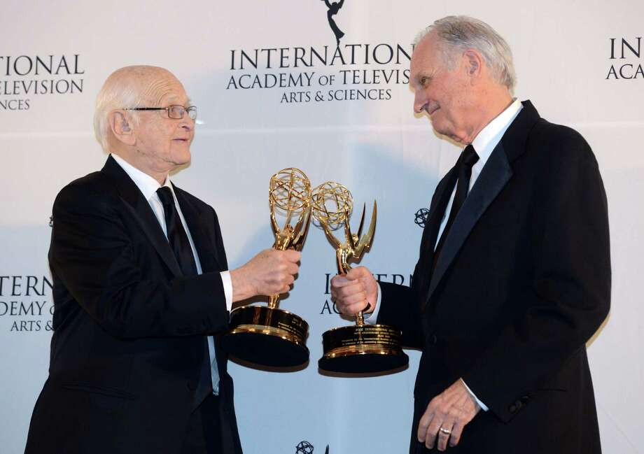 Alan Alda, right, touches statues with Norman Lear after winning Special Founders Awards at the 40th International Emmy Awards,  Monday, Nov. 19, 2012 in New York. Photo: Henny Ray Abrams, AP / FR151332 AP