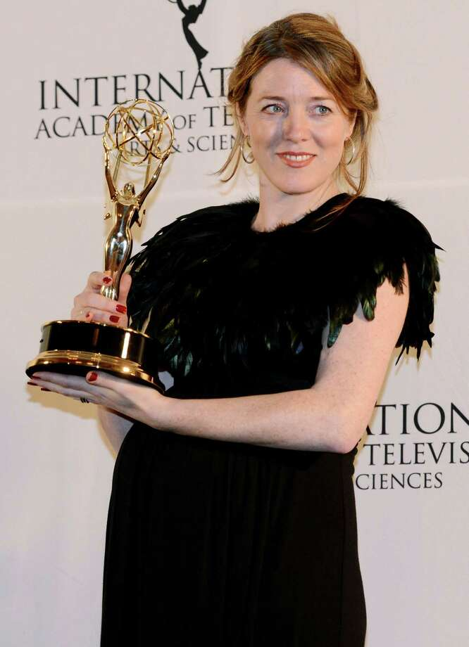 "Annabel Jones of Great Britain holds her emmy after winning the TV Movie/Mini-Series award for ""Black Mirror"" at the 40th International Emmy Awards,  Monday, Nov. 19, 2012 in New York. Photo: Henny Ray Abrams, AP / FR151332 AP"