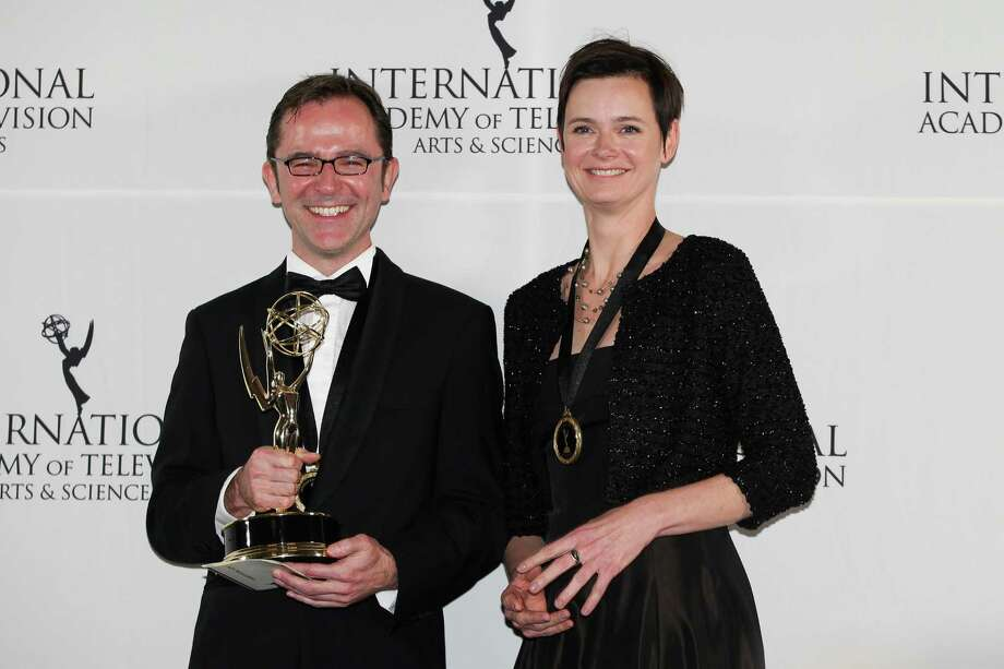 "This Nov. 19, 2012 photo released by Starpix shows Tristan Chytroschek, left, and Susanne Mertens pose with the award for Arts Programming for ""Songs of War"" at the 40th International Emmy Awards in New York. Photo: Andrew Toth, AP / STARPIX"