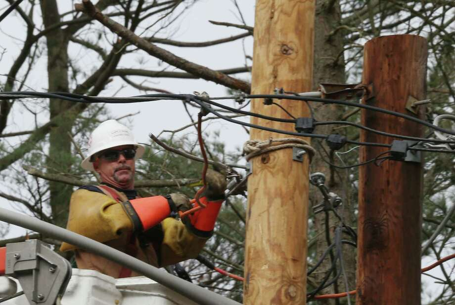 MELVILLE, NY - NOVEMBER 19:  An electrical crew member contracted by LIPA works on overhead lines on Old Country Road on November 19, 2012 in Melville, New York. Three weeks after Superstorm Sandy hit the New York area, LIPA continues its restoration efforts in many affected areas on Long Island. Photo: Bruce Bennett, Getty Images / 2012 Getty Images