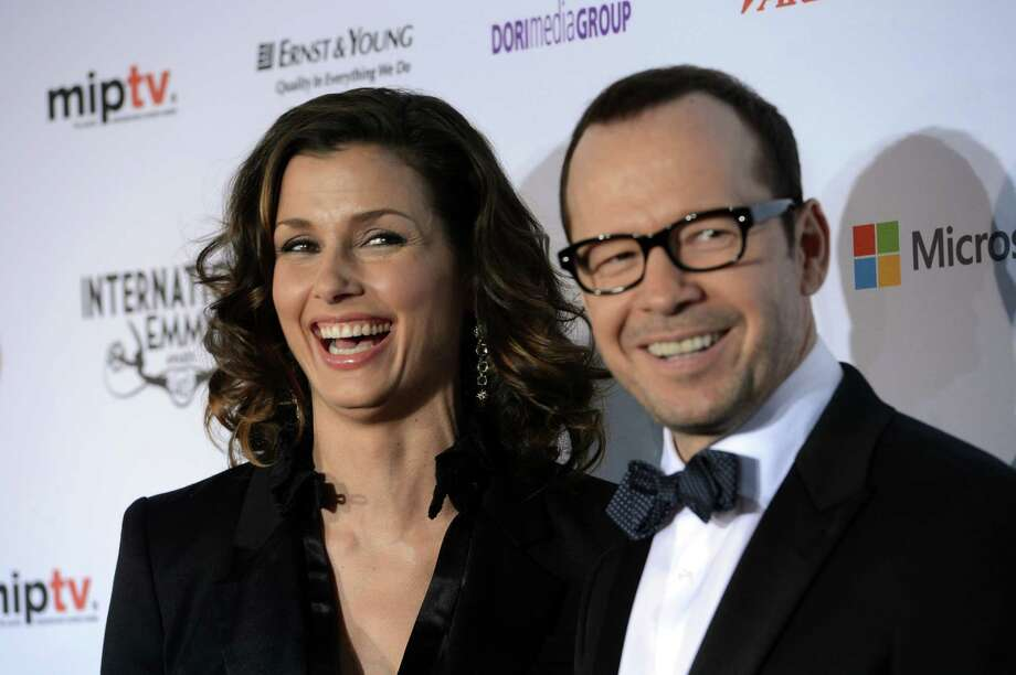 "Bridget Moynihan, left, and Donnie Wahlberg of the CBS series ""Blue Bloods,"" arrive for the 40th International Emmy Awards,  Monday, Nov. 19, 2012 in New York. Photo: Henny Ray Abrams, AP / FR151332 AP"