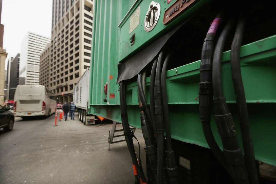 NEW YORK, NY - NOVEMBER 19:  A generator sits outside a Financial District building that flooded during Superstorm Sandy in lower Manhattan on November 19, 2012 in New York City. Many of the office towers in the low lying Financial District which flooded remain closed due to damage to heating and electrical infrastructure.  Many other buildings in the area are being powered by generators. Photo: Mario Tama, Getty Images / 2012 Getty Images