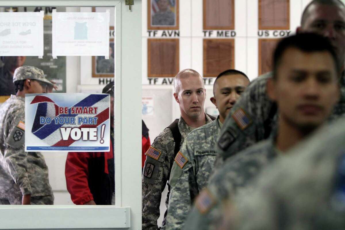 Progress has been made in helping U.S. military personnel vote in elections at home, but more needs to be done to address technical issues faced by elections administrators.