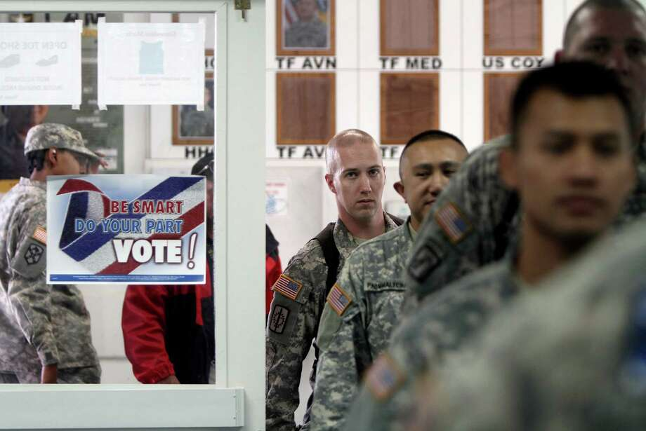 Progress has been made in helping U.S. military personnel vote in elections at home, but more needs to be done to address technical issues faced by elections administrators. Photo: Associated Press / AP