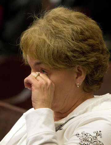 Patty Sparks wipes her eye after Jessica Tata was sentenced to 80 years in prison Tuesday, Nov. 20, 2012, in Houston. Tata was sentenced after a Feb. 24, 2011 home day care fire killed four toddlers.  (Cody Duty / Houston Chronicle)