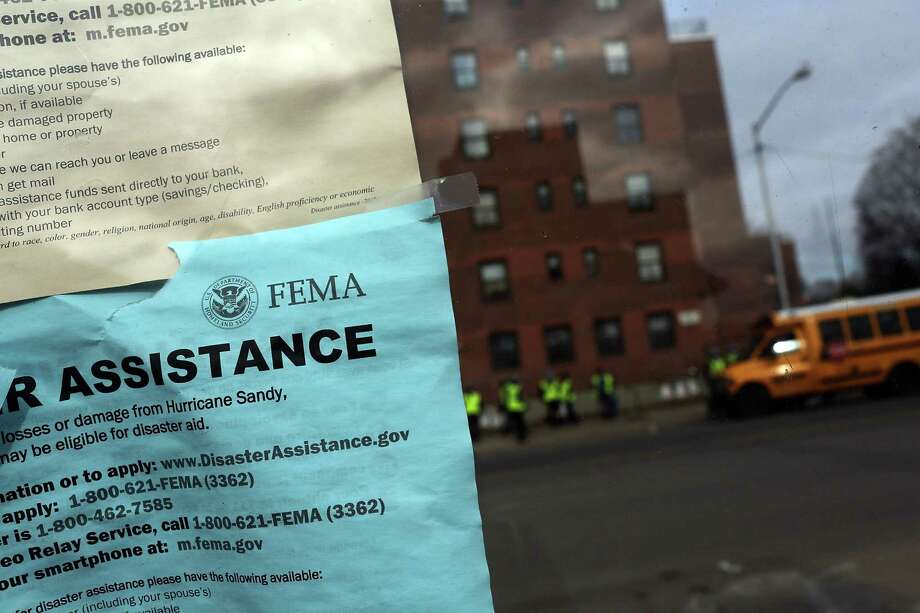 NEW YORK, NY - NOVEMBER 19:  A notice from FEMA for assistance hangs on a window in the heavily damaged Rockaway neighborhood, where a large section of the iconic boardwalk was washed away on November 19, 2012 in the Queens borough of New York City. Three weeks after Superstorm Sandy slammed into parts of New York and New Jersey, thousands are still without power and heat. Photo: Spencer Platt, Getty Images / 2012 Getty Images