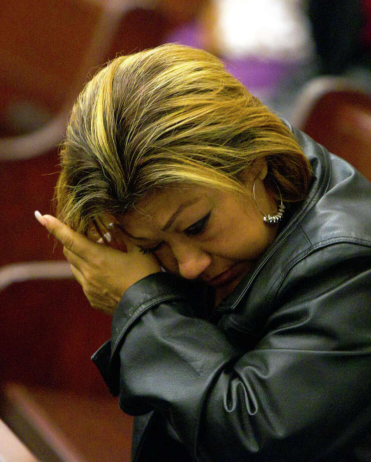 Rosie Castillo wipes her eye wipes her eye after Jessica Tata was sentenced to 80 years in prison Tuesday, Nov. 20, 2012, in Houston. Tata was sentenced after a Feb. 24, 2011 home day care fire killed four toddlers. Castillo is the grandma of Elias Castillo, a toddler who was killed in the fire. Photo: Cody Duty, Houston Chronicle / © 2012 Houston Chronicle