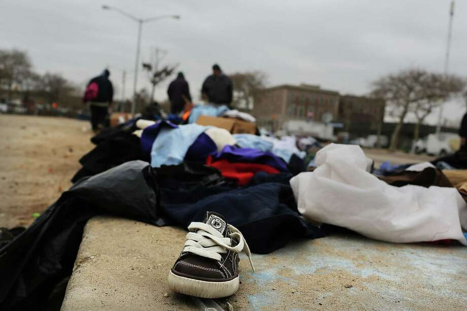 NEW YORK, NY - NOVEMBER 19:  Donated clothes for needy residents sit in a parking lot in the heavily damaged Rockaway neighborhood, where a large section of the iconic boardwalk was washed away on November 19, 2012 in the Queens borough of New York City. Three weeks after Superstorm Sandy slammed into parts of New York and New Jersey, thousands are still without power and heat. Photo: Spencer Platt, Getty Images / 2012 Getty Images