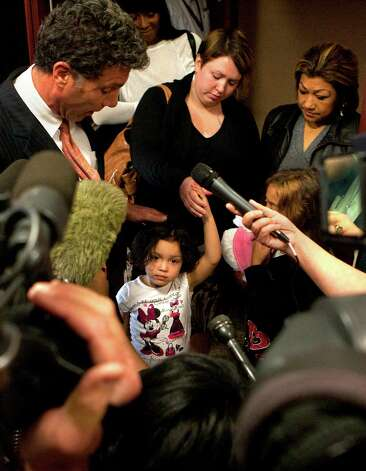 Harris County prosecutor Steven Baldassano, left, stands with Tiffany Dickerson, center, and her kids Makayla Dickerson, and Kiyanna Richardson, along with Rosie Castillo, right, after Jessica Tata's sentencing Tuesday, Nov. 20, 2012, in Houston. Tata was sentenced 80 years after a Feb. 24, 2011 home day care fire killed four toddlers including Dickerson's child along with Castillo's grandchild. Photo: Cody Duty, Houston Chronicle / © 2012 Houston Chronicle