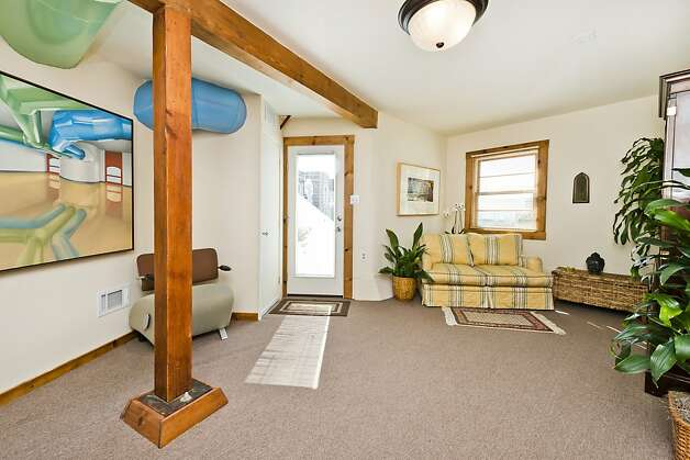 The lower level has exposed beams for a rustic touch and a bonus room with separate street access. Photo: Olga Soboleva