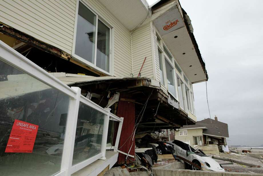 An beachside house deemed uninhabitable by the New York City Department of Buildings is shown in the Belle Harbor neighborhood of the Rockaways, Monday, Nov. 19, 2012, in New York. Photo: Kathy Willens, AP / AP