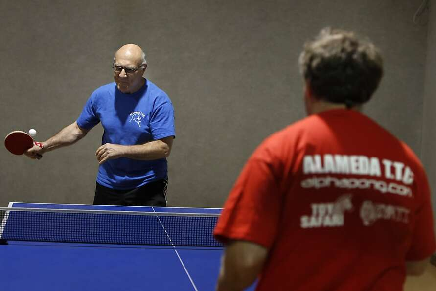 Dr. Leslie Prins (left) plays pingpong at Alameda Table Tennis Club with coach Avishy Schmidt.