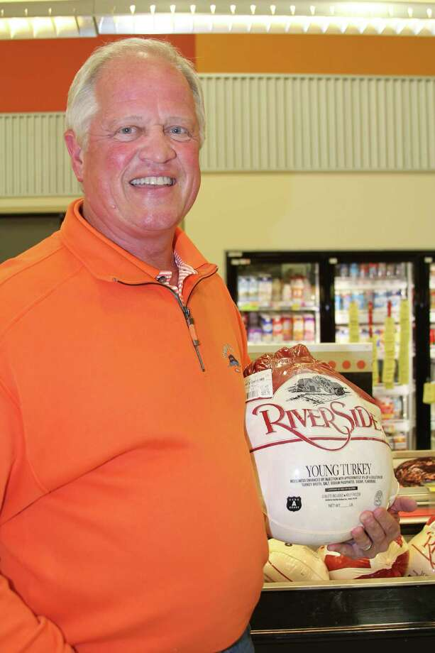 Bill Lane, a founder of the Christian Men of Boerne, says the organization's annual turkey fry brings together and bonds its participants, who prepare up to 300 turkeys and fixings for families in need. Photo: Lauri Gray Eaton