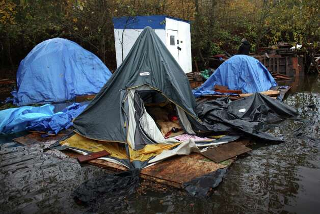 A tent and the resident's belongings float after record rainfall flooded Seattle's Nickelsville homeless camp at 7116 West Marginal Way South. Tents and the pallets they rested on were floating after the camp filled with up to one foot of water after Monday's record rain. The camp is in need of dry blankets (fleece), new tarps, tents, dry clothing, and gas to power the pumps and generators. Organizers welcome the donations at the camp, 7116 West Marginal Way South. Photo: JOSHUA TRUJILLO / SEATTLEPI.COM