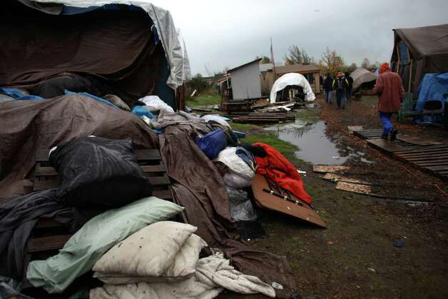 Waterlogged blankets, pillows and clothes are shown after record rainfall flooded Seattle's Nickelsville homeless camp at 7116 West Marginal Way South. Tents and the pallets they rested on were floating after the camp filled with up to one foot of water after Monday's record rain. The camp is in need of dry blankets (fleece), new tarps, tents, dry clothing, and gas to power the pumps and generators. Organizers welcome the donations at the camp, 7116 West Marginal Way South. Photo: JOSHUA TRUJILLO / SEATTLEPI.COM